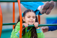 Girl in climbing frame